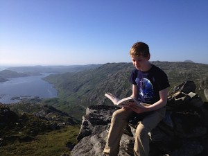 4th Prize to our Scottish mountain Extreme Reader. Pictured reading '101 Ideas that Changed the World'